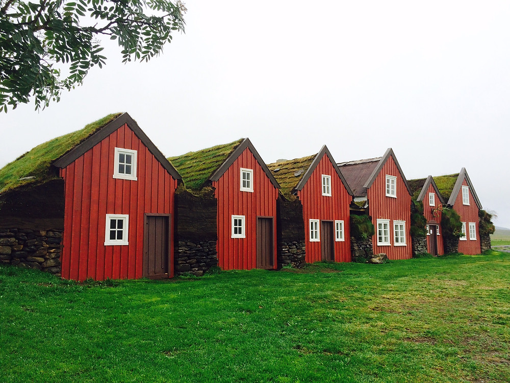 Bustarfell turf house museum in Iceland on foggy day