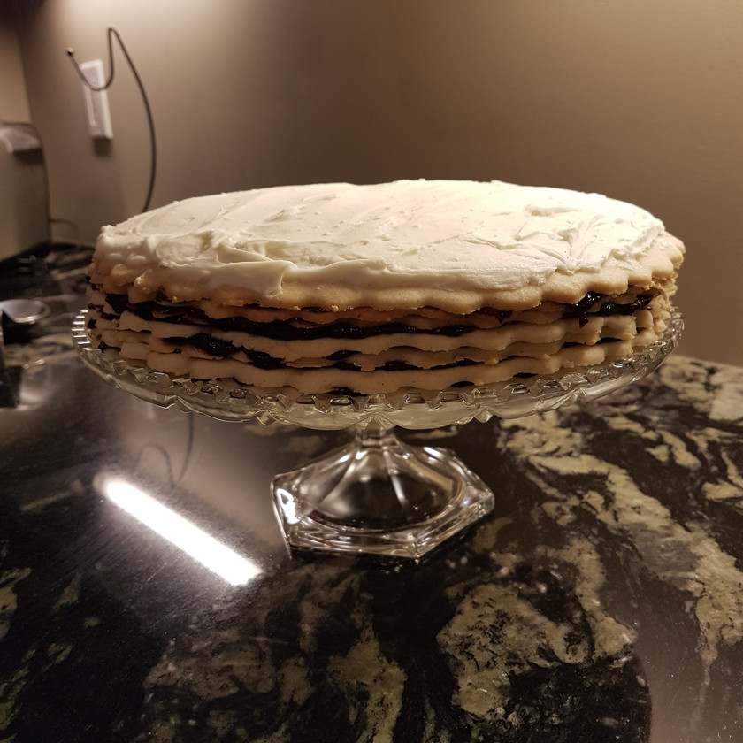 7 layer vinarterta with icing resting on crystal cake stand