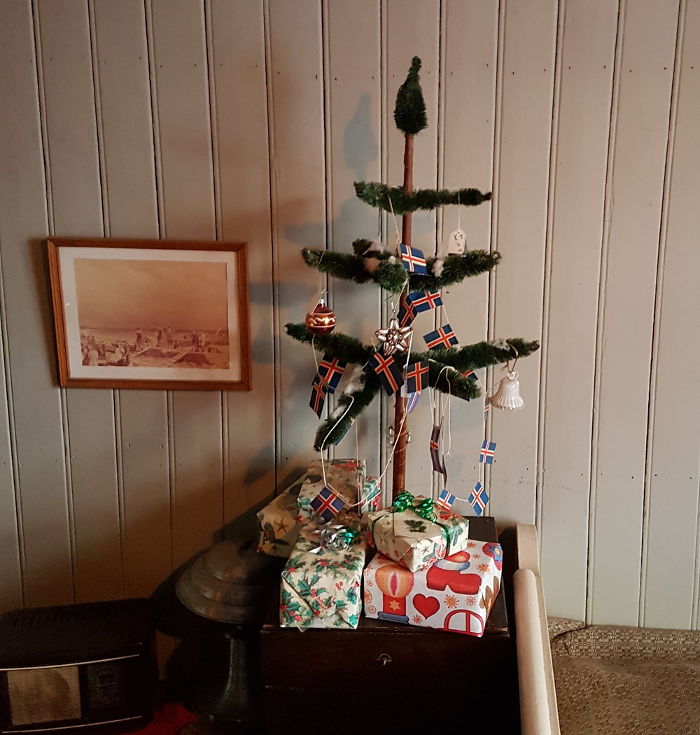homemade christmas tree with wrapped presents below