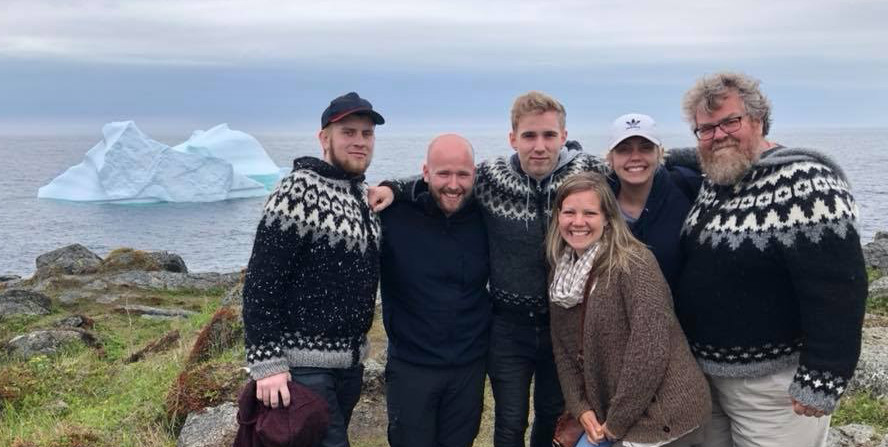 Snorri West group in Newfoundland in front of an iceberg.