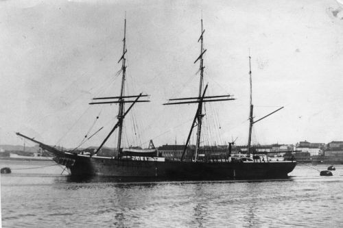 black and white image of the Elwood cooper ship in an unidentified port