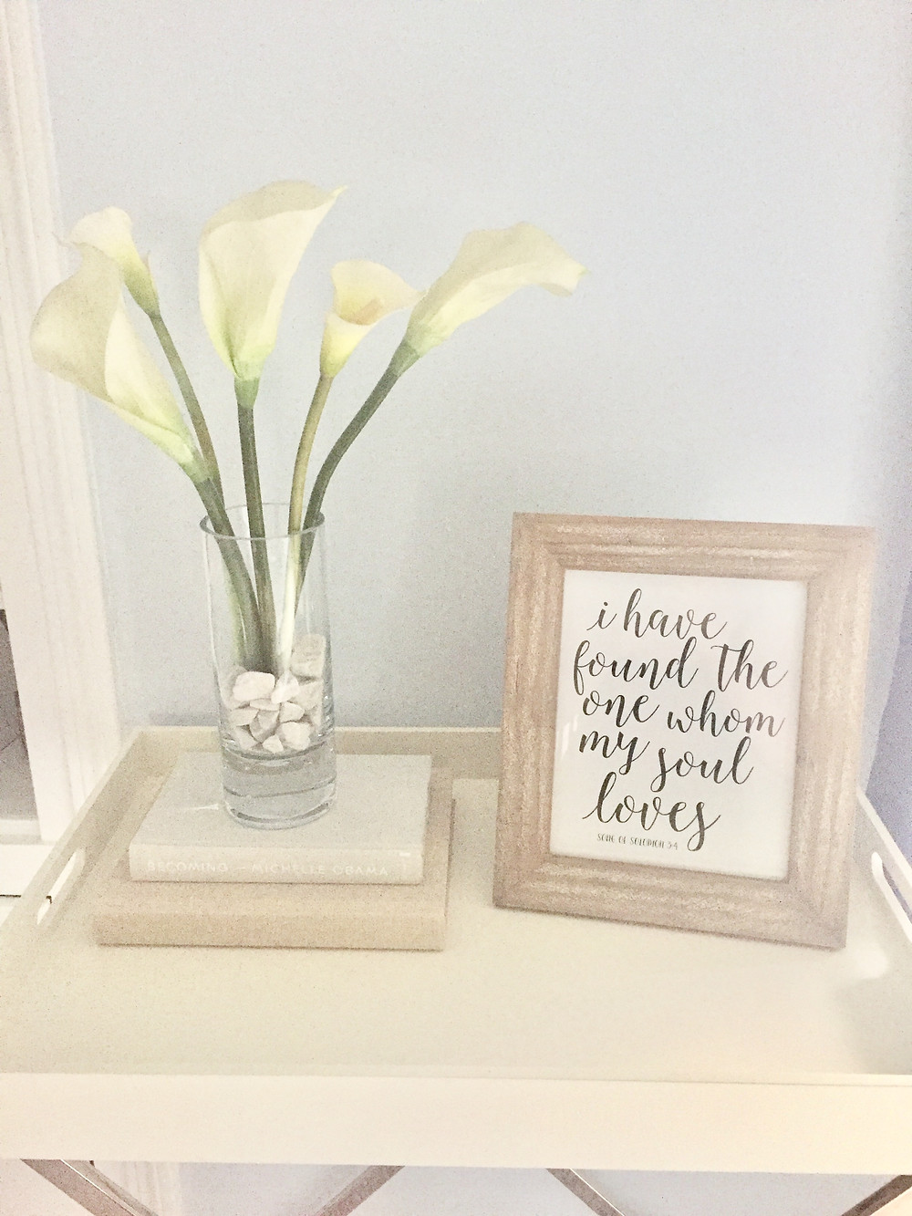 Wood tray and stand with vase of flowers books framed photo