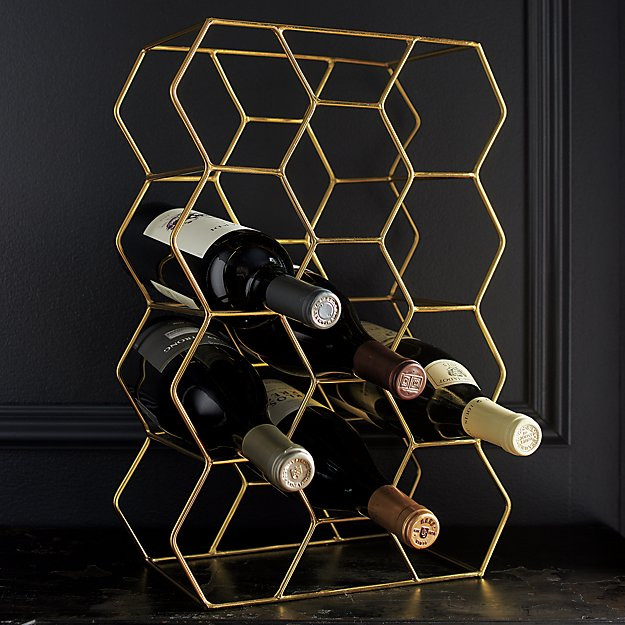Gold Crate and Barrel wine rack with wine bottles
