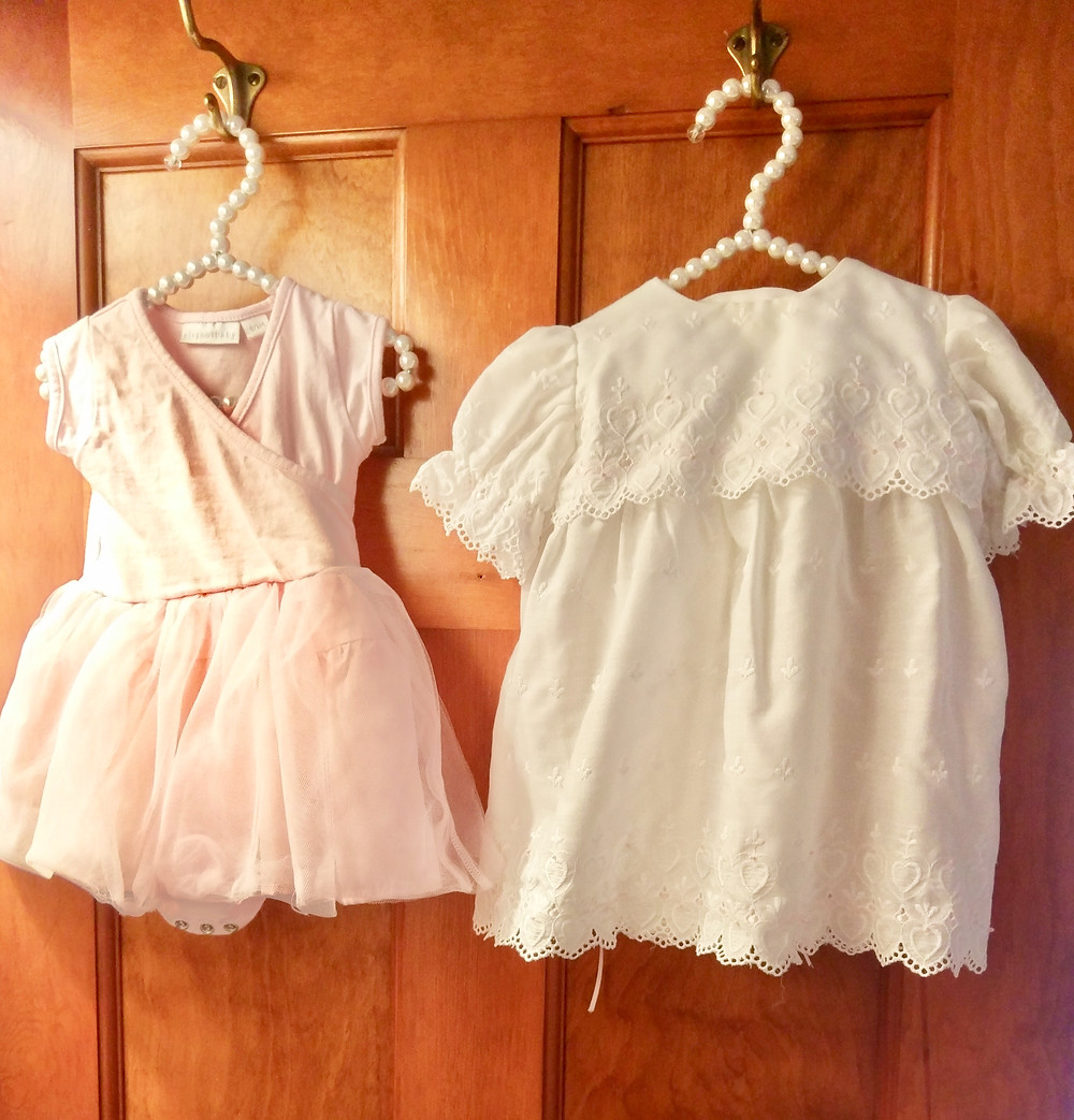 Baby girl dresses hanging in closet