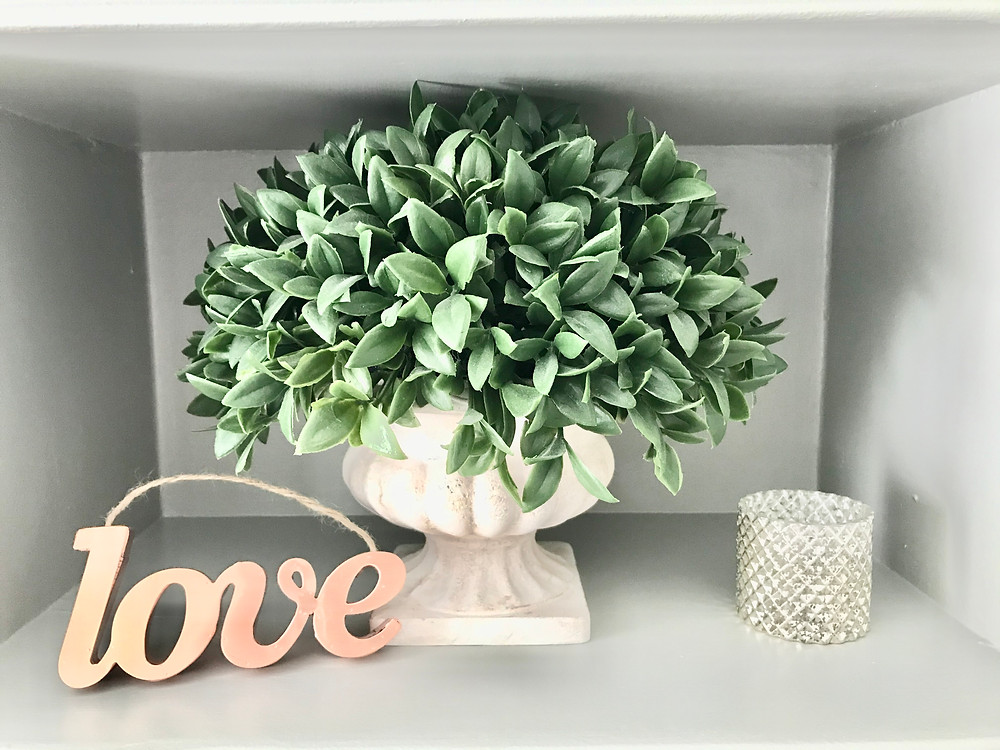 Built ins shelf styling home decor tips greenery plants candle holders