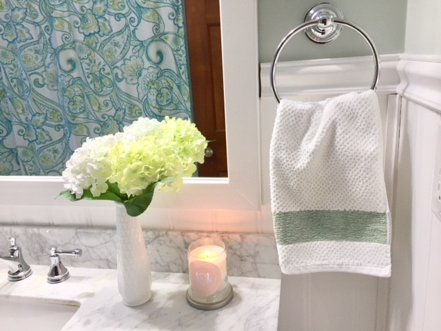 Farmhouse style bathroom white and green hydrangeas