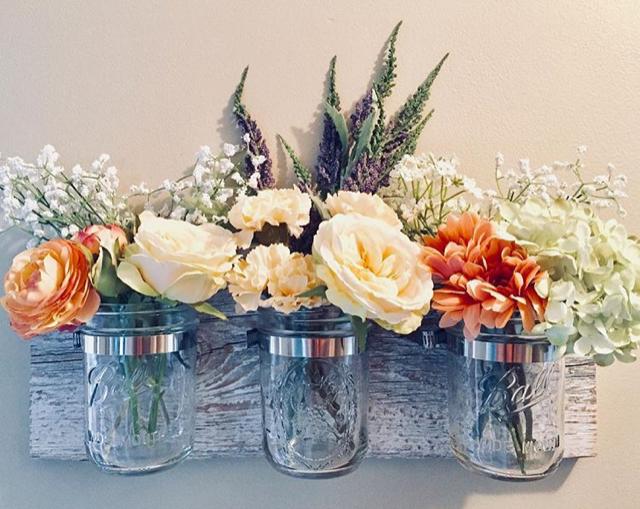 Farmhouse style flowers in mason jars