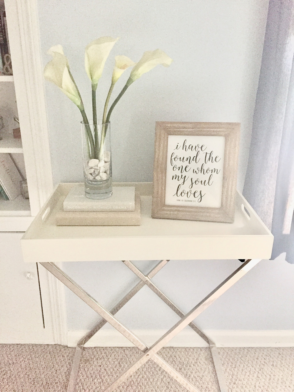 Tray and stand with vase of flowers books framed photo