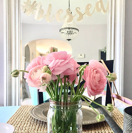 Pink flowers dining room centerpiece