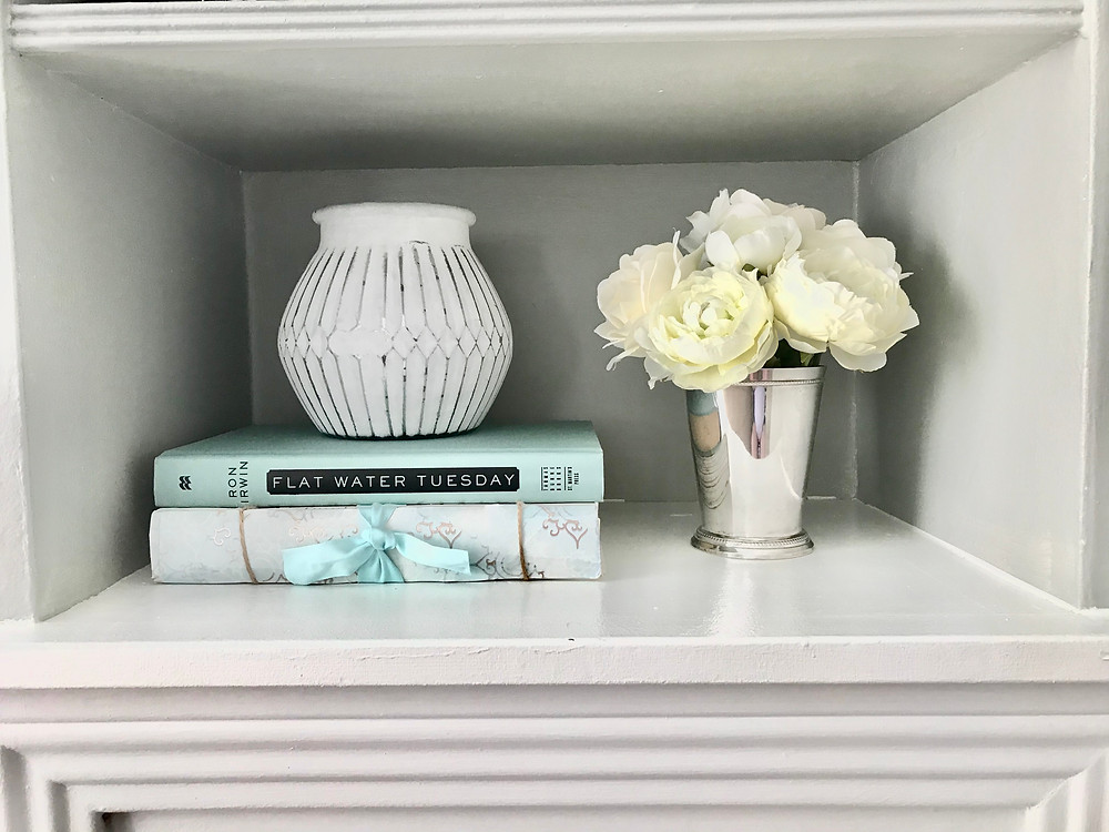 Built ins shelf styling home decor tips books vases flowers