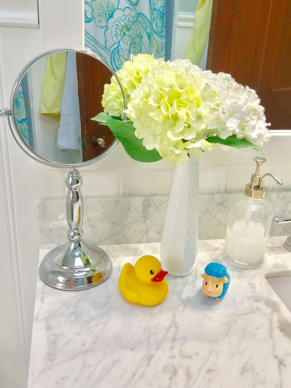 Farmhouse bathroom style with baby bath toys
