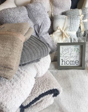 Blankets with wooden sign