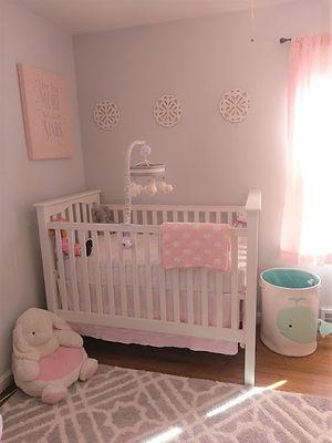 Baby girl pink gray nursery interior design
