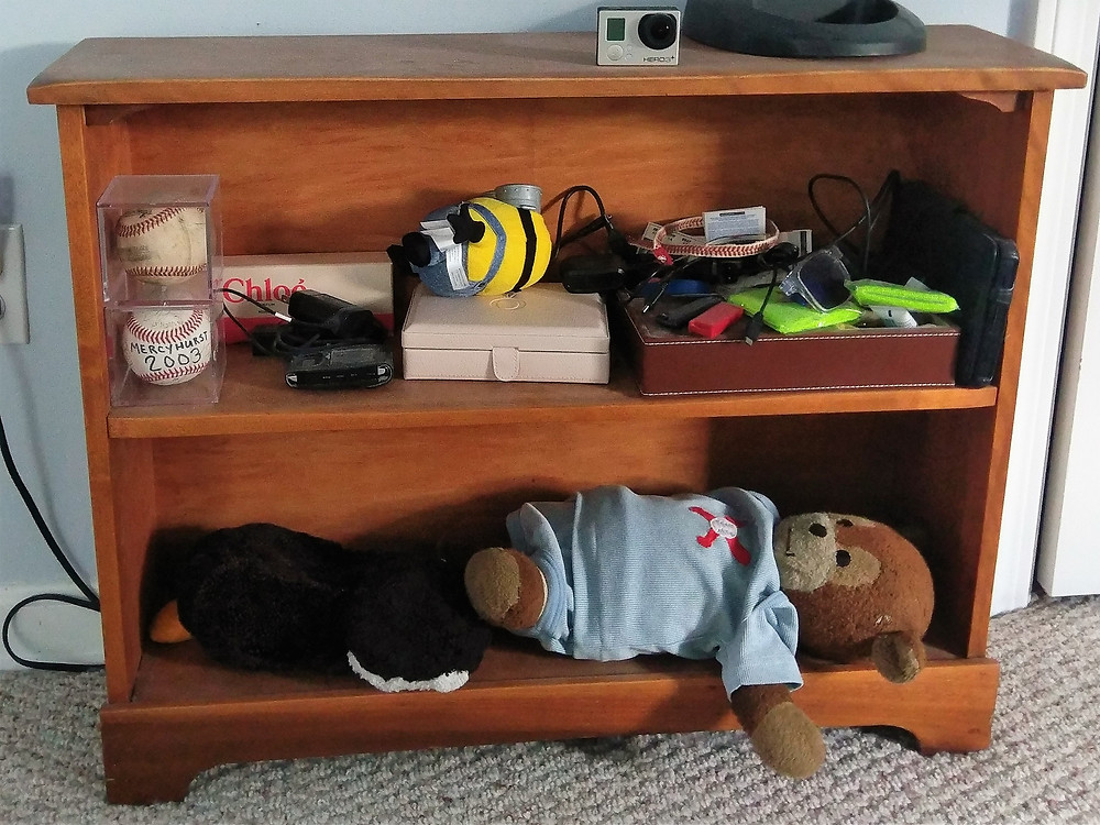 Shelf before: clutter and chaos