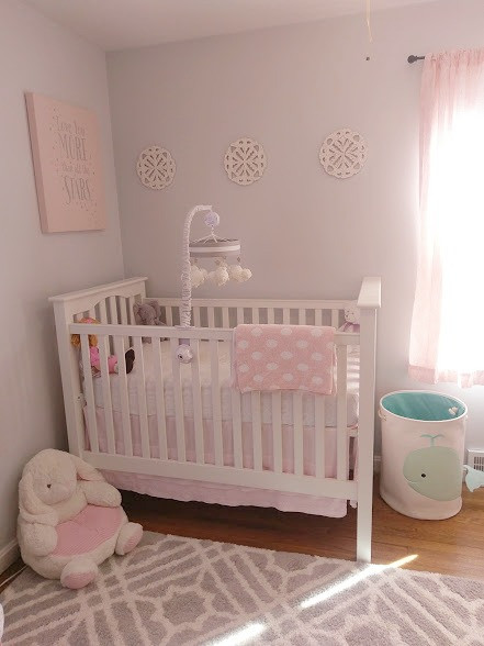 Baby girl's nursery with white crib