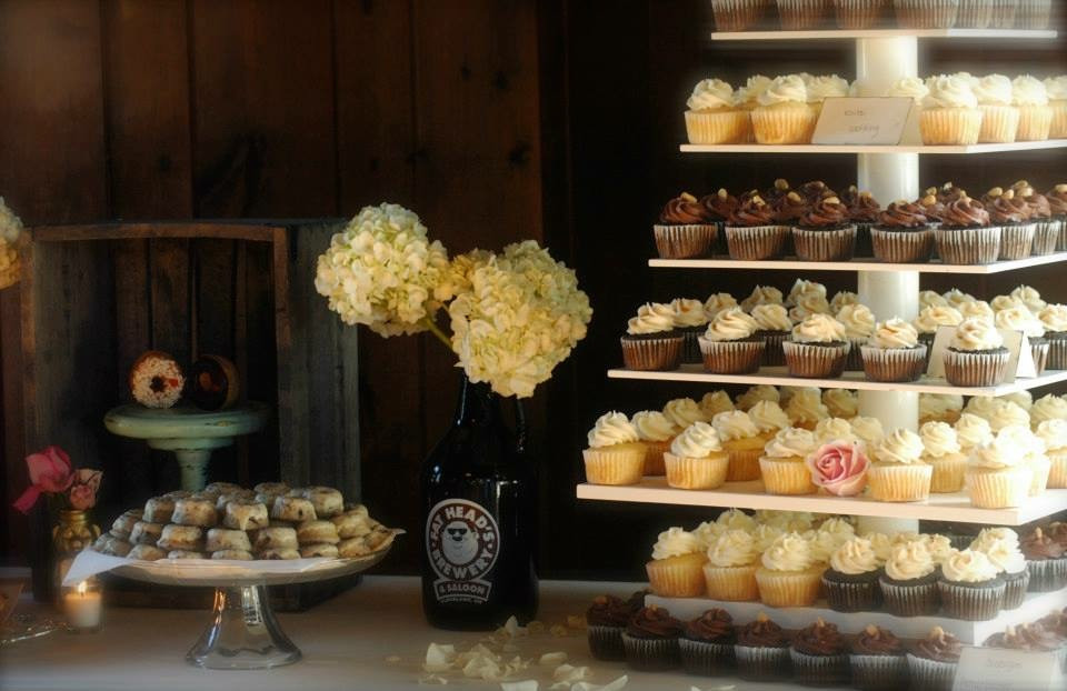 Rustic romantic wedding dessert table donuts cupcakes