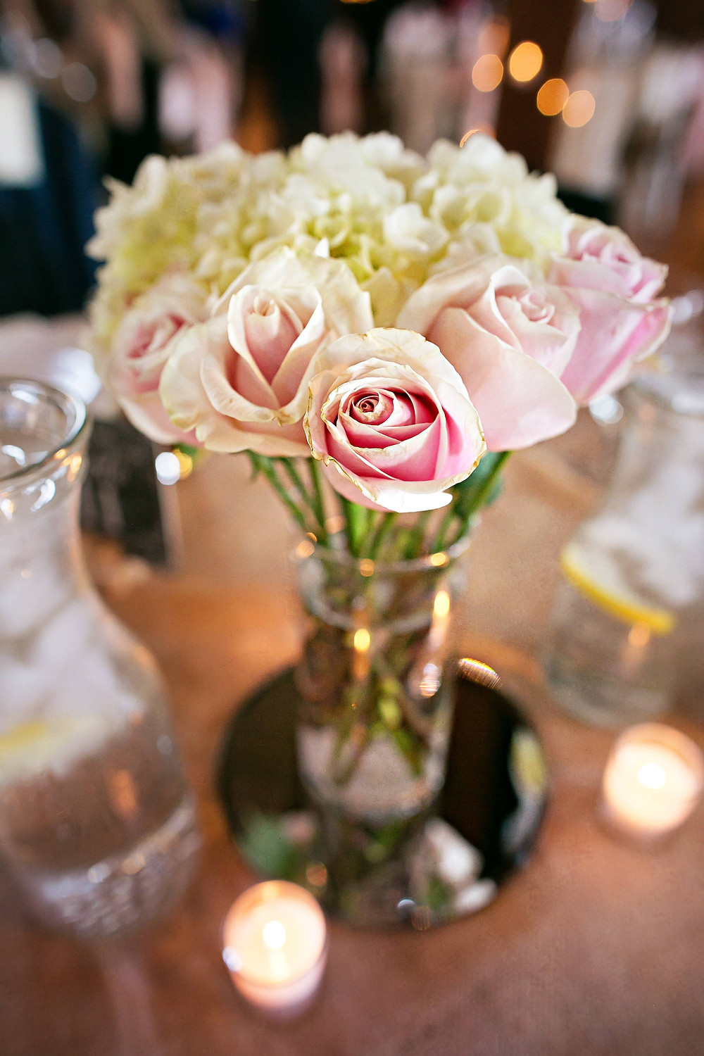 Rustic romantic wedding centerpiece of roses and hydrangeas
