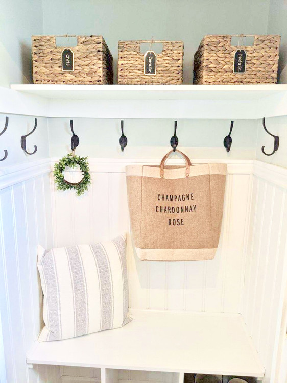 Simple chic storage: A coastal farmhouse mudroom closet