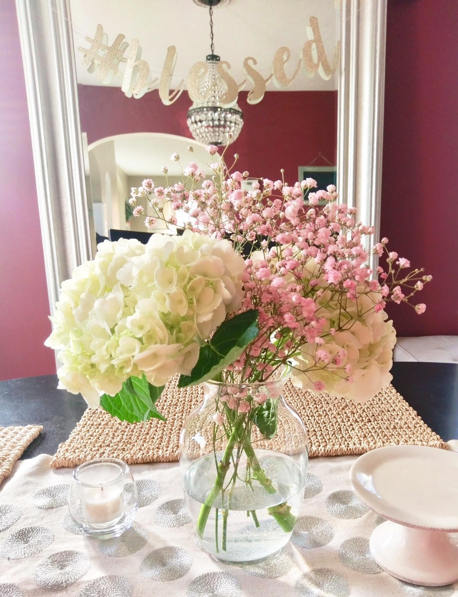 White hydrangeas with pink baby's breath