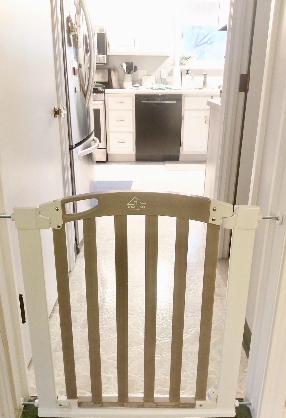Gray and white infant baby gate
