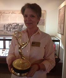 Stannard Preston with one of the three Emmy awards