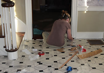 Jennifer Frantz installs the floorcloth