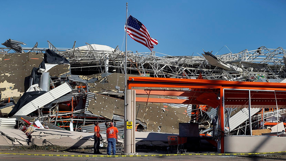 "From article, ""The Home Depot employees A.J. Kobena (center) raised the U.S. flag on the slightly bent flagpole outside the destroyed store just east N. Central Expressway on Forest Lane in Dallas, Monday, October 21, 2019. Joining him were store manager Jonathan Shields and assistant store manager Jordan Jasper. A tornado tore through the entire neighborhood knocking down trees and ripping roofs from homes.(Tom Fox / Staff Photographer)"""