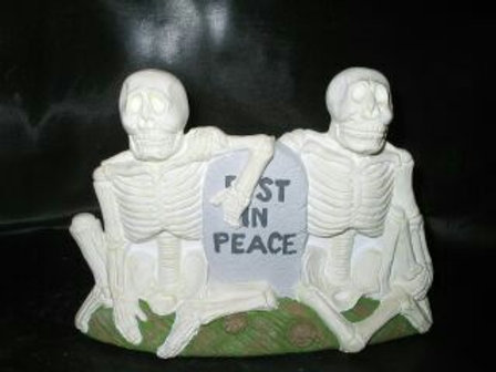 Skeletons with tombstone