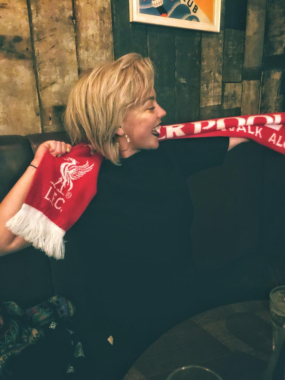 Blonde girl in English Pub, Liverpool FC Scarf