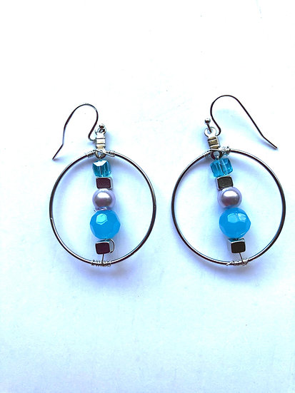 Blue beaded with silver and white rounded design