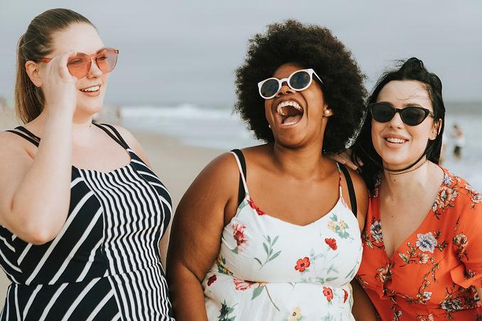 3 girls at beach with sunglasses.jpg
