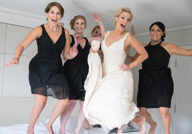 bride and bridesmaids jumping.jpeg