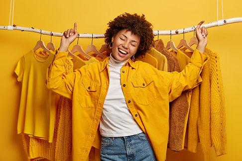 1 girl - gold shirt with shirts behind.jpg