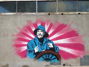 muurschildering schipper Havenkwartier