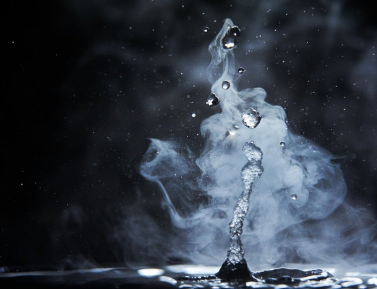 boiling-water-splash-with-steam-black-ba