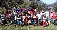 Swazi feeding the children.JPG