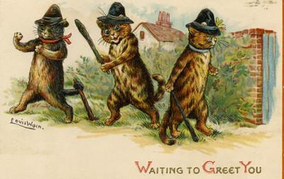 Tre katter förbereder en liten julhälsning.