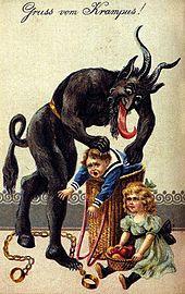 Krampus stoppar två olydiga barn i sin säck.