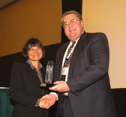 MMC 2003 named top sales exec award from Newspaper Association of America for 2002