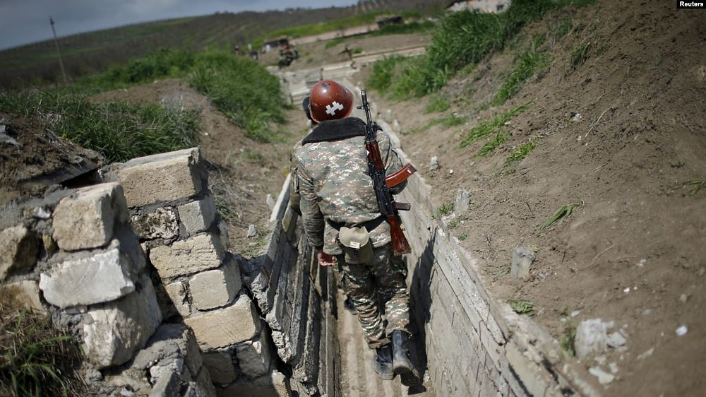 Ethnic Armenian soldiers in a trench close to the border with Nagorno-Karabakh (file photo from 2016)