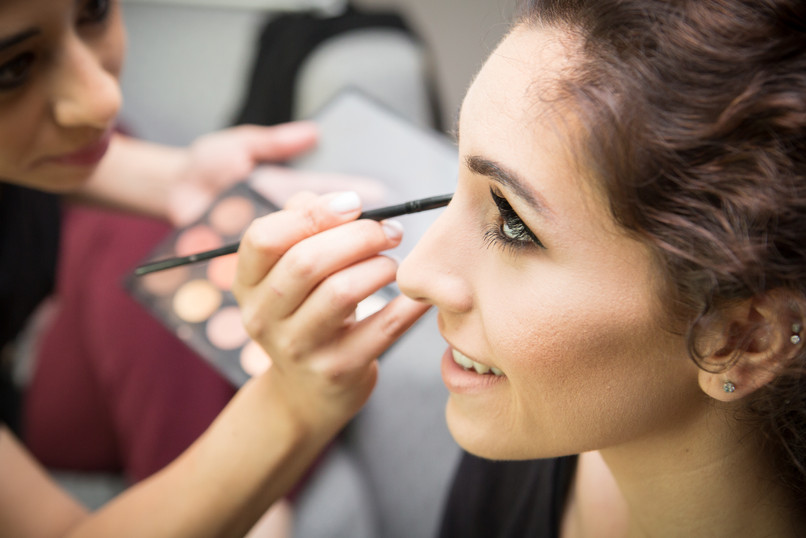 Bride getting ready with MUA