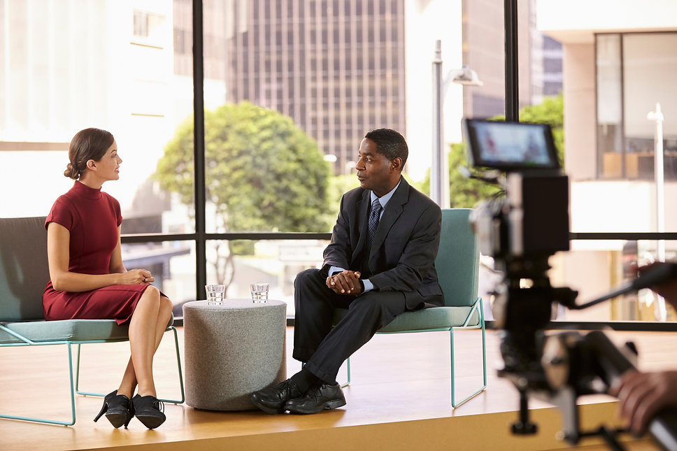 black-man-and-white-woman-on-set-filming