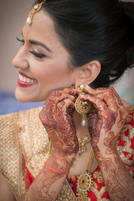 Bride earrings before ceremony