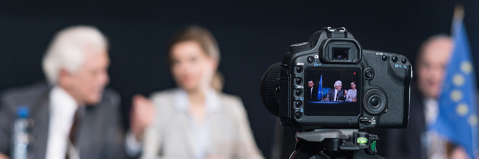 camera-recording-businesspeople-during-p