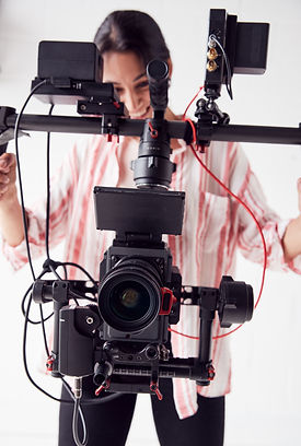 female-videographer-with-video-camera-on