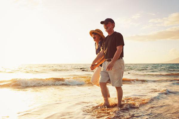 Senior Couple Enjoying Sunset at the Bea