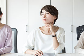 Thinking young woman in the office..jpg