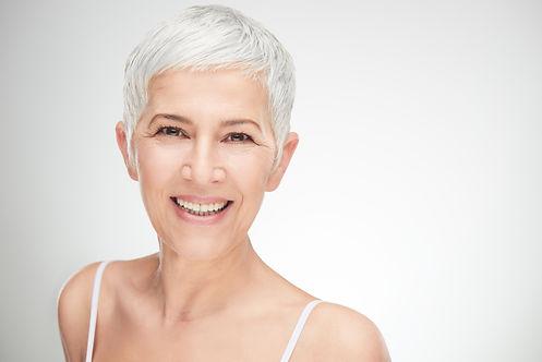 Portrait of beautiful senior woman in fr