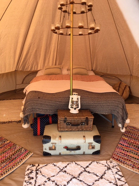 old suitases vintage styling interior bell tent camping decorating tent