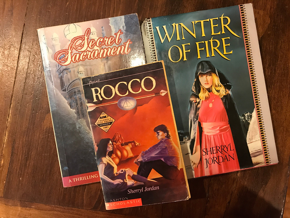 a collection of books - rocco, the sacred sacrament, winter of fire